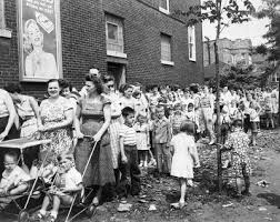 Families lining up for their polio vaccination, 1955.